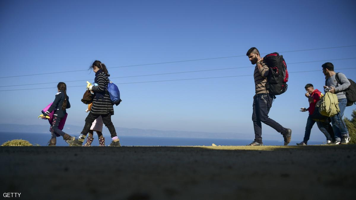 Syrian refugees walk up to the hill after arriving on the Greek island of Lesbos after crossing the Aegean Sea from Turkey on November 19, 2015. European leaders tried to focus on joint action with Africa to tackle the migration crisis, as Slovenia became the latest EU member to act on its own by barricading its border. AFP PHOTO/BULENT KILIC        (Photo credit should read BULENT KILIC/AFP/Getty Images)