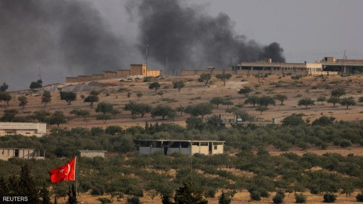 Smoke rises from the Syrian border town of Jarablus as it is pictured from the Turkish town of Karkamis, in the southeastern Gaziantep province, Turkey, August 24, 2016. REUTERS/Umit Bektas